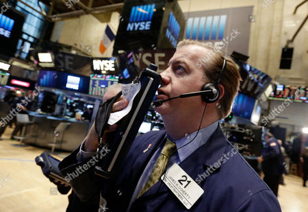 James Doherty Trader James Doherty works on the floor of the New York Stock Exchange . U.S. stock indexes are creeping higher Tuesday, as the market bounces back from a loss the day before
