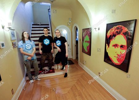 Stock Picture of The members of StreamerHouse, from left, Brett Borden, Adam Young and Robert Schill pose for a photo in their 1920s-era Mediterranean-revival home in Lakeland, Fla. StreamerHouse, an online form of entertainment, is part Big Brother, part talk radio and part performance art. The trio play games, chat with fans and narrate their daily lives