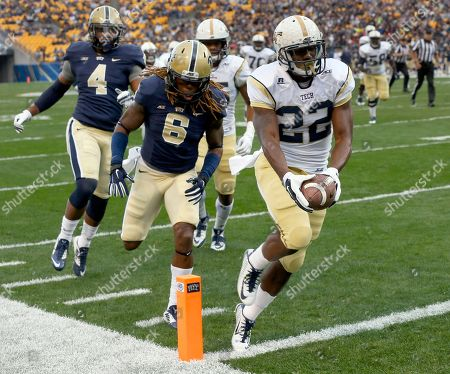 Broderick Snoddy, Todd Thomas Georgia Tech running back Broderick Snoddy (22) outruns Pittsburgh linebacker Todd Thomas (8) for a touchdown in the first quarter of an NCAA football game, in Pittsburgh