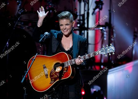 Natalie Maines Lead singer Natalie Maines of the Dixie Chicks waves after performing during a tribute concert to Billy Joel, the recipient of the Library of Congress Gershwin Prize for Popular Song, at DAR Constitution Hall in Washington