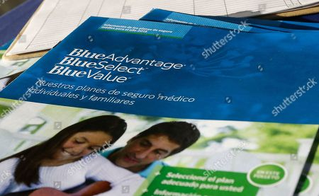 Flyers promoting Blue Cross Blue Shield and Obama Care are on display to attract Hispanic customers at a kiosk at Compare Foods in Winston-Salem, N.C. Such atypical approaches to selling health insurance policies are playing out across the country since the second round of open enrollment under the federal Affordable Care Act opened in mid-November. Insurance companies and some states are focusing heavily on signing up eligible Hispanics, a group that accounts for a large share of the nation's uninsured but largely avoided applying for coverage during the first full year the health care reform law was in effect. Hispanics accounted for just 11 percent of those who enrolled in the private policies sold during the initial sign-up period, which ended in March