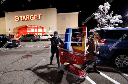 Shannon Johnson, Elizabeth Withers Shannon Johnson, left, and Elizabeth Withers, of Windham, Maine, wheel a 48-inch flat screen television out to their car after shopping at Target at midnight on Black, in South Portland, Maine