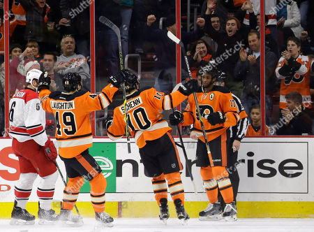 Wayne Simmonds Philadelphia Flyers' Wayne Simmonds (17) celebrates with Brayden Schenn (10) and Scott Laughton (49) after scoring a goal during the first period of an NHL hockey game against the Carolina Hurricanes, in Philadelphia