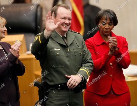 Jim McDonnell, Jackie Lacey Sheriff elect Jim McDonnell, left, is sworn in as the new Los Angeles County Sheriff's by Los Angeles County District Attorney, Jackie Lacey, right, in Los Angeles, . He replaces Lee Baca, who retired in January amid a federal investigation of alleged county jail corruption and abuse. McDonnell has served more than three decades in law enforcement. He was second-in-command of the Los Angeles Police Department under former Chief Bill Bratton and was chief of the Long Beach department since 2010