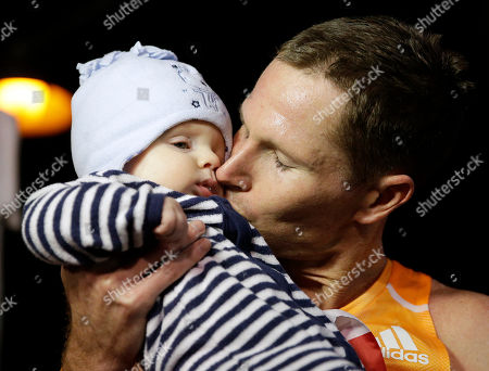 Ben Bruce, Riley Bruce Ben Bruce kisses his five-month-old son Riley after winning the Rock 'n' Roll Las Vegas Marathon, in Las Vegas
