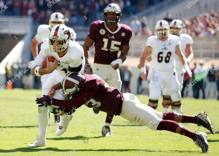 Shaan Washington, Pete Thomas Louisiana Monroe quarterback Pete Thomas is stopped after a short gain by Texas A&M's Shaan Washington in the second half of an NCAA college football game, in College Station, Texas. The Aggies won 21-16