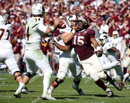 Myles Garrett, Chase Regian, Pete Thomas Louisiana Monroe quarterback Pete Thomas (14) prepares to throw as offensive lineman Chase Regian (71) defends against a rush by Texas A&M's Myles Garrett (15) in the second half of an NCAA college football game, in College Station, Texas. Garrett led the defense on Saturday with 3 ½ sacks to give him 11 this season and break Jadeveon Clowney's SEC freshman sack record of eight set in 2011 at South Carolina. The Aggies won 21-16