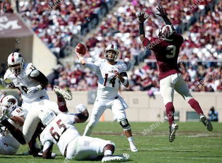 Pete Thomas, Tommy Sanders Louisiana Monroe quarterback Pete Thomas (14) attempts to pass as Texas A&M linebacker Tommy Sanders (3) pressures in the second half of an NCAA college football game, in College Station, Texas. The Aggies won 21-16