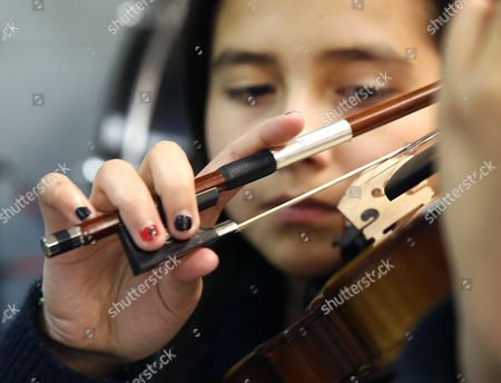 Gisselle Bahena practices her violin at the Richard Edwards Elementary School, in Chicago. Chicago now joins dozens of schools districts across the country in cities like Las Vegas, San Antonio and Tucson, Arizona, that teach mariachi music in schools. It's a way to connect schools and parents from Hispanic communities, says organizers