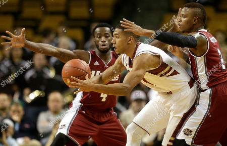 Jabarie Hinds, Olivier Hanlan, Derrick Gordon Massachusetts guard Jabarie Hinds, left, and guard Derrick Gordon, right, try to block Boston College guard Olivier Hanlan, center, in the first half of an NCAA college basketball game, in Boston