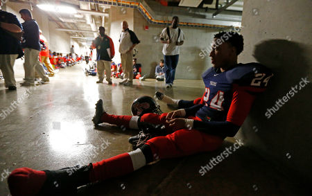 James Ellis South Panola defensive back James Ellis sits in a darkened hallway of Davis Wade Stadium at Mississippi State in Starkville, Miss., after the lights went out early in the first quarter of the Mississippi 6A Championship high school football game against Oak Grove on