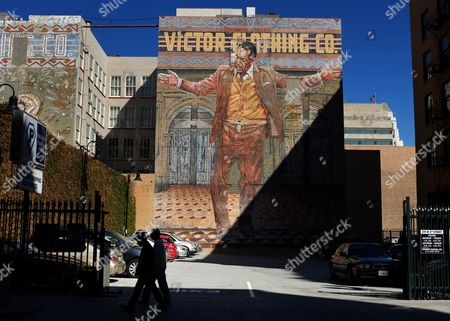 """Anthony Quinn Pedestrians walk by a mural of a 70-foot-tall depiction of two-time Oscar-winning actor Anthony Quinn on a street in downtown Los Angeles on . The mural titled """"The Pope of Broadway,"""" that's towered over downtown Los Angeles for nearly three decades is getting a makeover. Actor Edward James Olmos and others have announced a plan to restore the portrait of Quinn"""