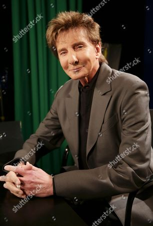 """Barry Manilow Singer-songwriter and producer Barry Manilow poses for a photograph during an Associated Press interview in New York, . The 71 year-old Manilow has just released his latest album, """"My Dream Duets,"""" in which he performs along with his favorite singers, all of whom are deceased. Through the use of modern technology, Manilow croons along with such well-known musical legends as Judy Garland, Jimmy Durante, Louis Armstrong, Sammy Davis Jr., and others"""