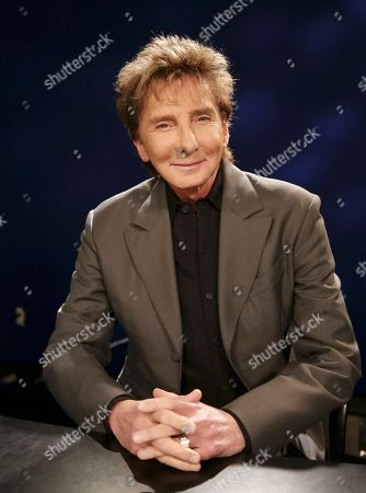 """Barry Manilow Singer-songwriter and producer Barry Manilow poses for a photograph during an Associated Press interview in New York, . The 71 year-old Manilow has just released his latest album, """"My Dream Duets,"""" in which he performs along with his favorite singers, all of whom are deceased. Through the use of modern technology, Manilow croons along with such musical legends as Judy Garland, Jimmy Durante, Louis Armstrong, Sammy Davis Jr., and others"""