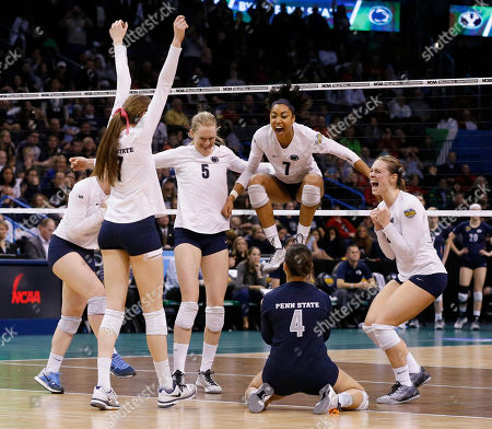 Penn State players celebrate after scoring the winning point against BYU, right, during the NCAA women's volleyball tournament championship match in Oklahoma City, . Penn State won in three sets. From left at Penn State's Megan Courtney (17), Ali Frantti (5), Nia Grant (7), Dominique Gonzalez (4) and Micha Hancock (12