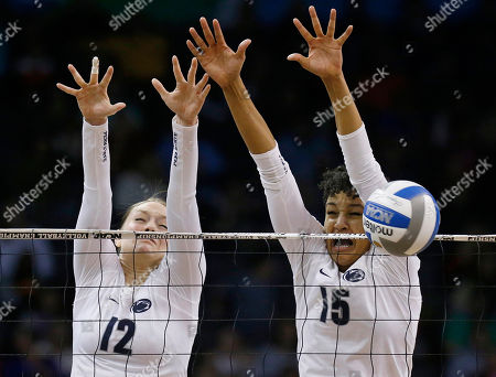 Micha Hancock, Haleigh Washington Penn State's Micha Hancock (12) and Haleigh Washington (15) block a shot by BYU during the NCAA women's volleyball tournament championship match in Oklahoma City, . Penn State won in three sets