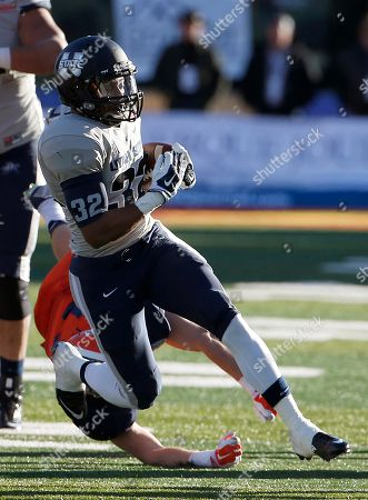Joe Hill, Wesley Miller Utah State's Joe Hill (32) gets past UTEP's Wesley Miller during the second half of the New Mexico Bowl NCAA college football game, in Albuquerque, N.M. Utah State defeated UTEP 21-6