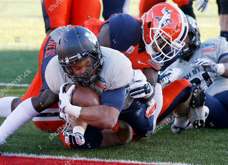 Joe Hill, Adrian James Utah State's Joe Hill, left, dives for the end zone for a touchdown as UTEP's Adrian James, right, is unable to make the tackle in time during the second half of the New Mexico Bowl NCAA college football game, in Albuquerque, N.M. Utah State won 21-6