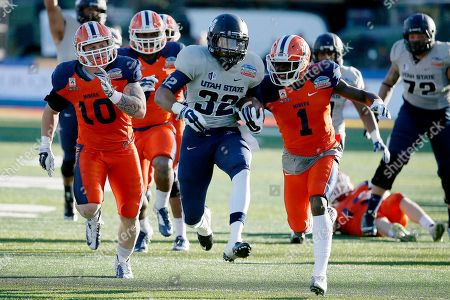 Joe Hill, Jimmy Musgrave, Adrian James Utah State's Joe Hill (32) gets past UTEP's Adrian James (1) and Jimmy Musgrave (10) for a long gain during the second half of the New Mexico Bowl NCAA college football game, in Albuquerque, N.M. Utah State defeated UTEP 21-6