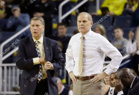 Stock Photo of Jeff Meyer, John Beilein Michigan head coach John Beilein, right, and assistant Jeff Meyer watch from the sideline during the first half of an NCAA college basketball game against Nicholls State in Ann Arbor, Mich