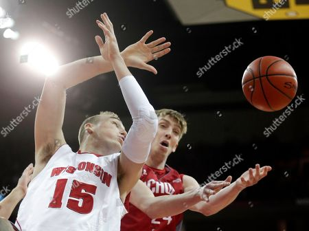 Stock Image of Wisconsin forward Sam Dekker, left, and Nicholls State forward Liam Thomas battle for a rebound during the first half of an NCAA college basketball game, in Madison, Wis
