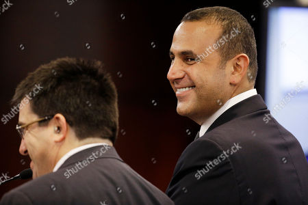 Sam Nazarian, Anthony Cabot Sam Nazarian, right, smiles while speaking with his attorney Anthony Cabot, left, before the Nevada Gaming Commission, in Las Vegas. Nazarian, a 10 percent owner of the SLS Las Vegas hotel and casino, appeared before the commission seeking a gaming license