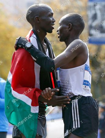 Geoffrey Mutai, Wilson Kipsang Geoffrey Mutai of Kenya, right, congratulates fellow Kenyan Wilson Kipsang after Kipsang won the men's division of the 44th annual New York City Marathon in New York, . Mutai, heavily favored, finished sixth