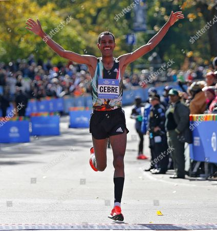 Stock Image of Gebre Gebremariam Gebre Gebremariam, of Ethiopia, celebrates after finishing third in the 44th annual New York City Marathon in New York