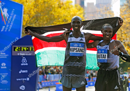 Stock Image of Wilson Kipsang, Geoffrey Mutai 2014 New York City men's marathon winner Wilson Kipsang of Kenya, left, poses holding a Kenyan flag with fellow Kenyan Geoffrey Mutai, after finishing the the 44th annual New York City Marathon in New York, . Mutai, who was the favorite, finished sixth