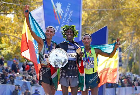 Gebre Gebremariam, Wilson Kipsang, Lelisa Desisa Men's winner Wilson Kipsang, center, is joined by second-place finisher Lelisa Desisa Benti, of the United States, left, and third place finisher Gebre Gebremariam, of Ethiopia, after the 44th annual New York City Marathon in New York