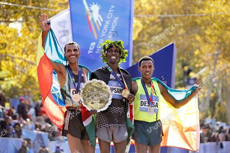 Gebre Gebremariam, Wilson Kipsang, Lelisa Desisa 2014 New York City Marathon winner Wilson Kipsang, center, is joined by second-place finisher Lelisa Desisa Benti of the United States, left, and third place finisher Gebre Gebremariam after the 44th annual New York City Marathon in New York