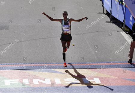 Gebre Gebremariam Gebre Gebremariam, of Ethiopia, crosses the finish line third in the men's division at the 2014 New York City Marathon in New York