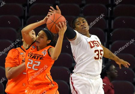 Brittney Martin, Kristen Simon Oklahoma State guard Brittney Martin (22) and Southern California forward Kristen Simon (35) reach for a rebound during the first half of an NCAA college basketball game, in Los Angeles