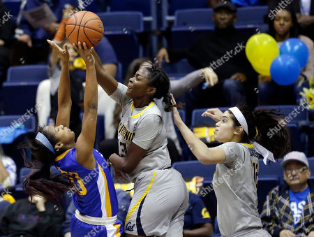Rachol West, Gabby Green San Jose State forward Rachol West, left, has her shot blocked by California guard Gabby Green, center, during the first half of an NCAA college basketball game, in Berkeley, Calif