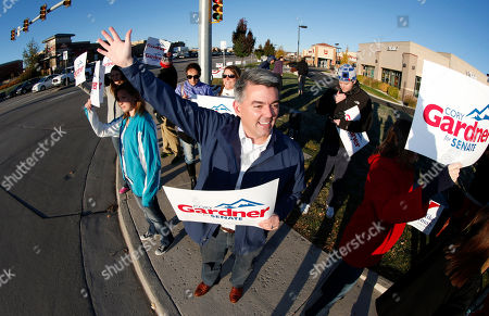 Cory Gardner As viewed through a fisheye lens, Cory Gardner, Republican candidate for the U.S. Senate seat in Colorado, joins supporters in waving placards on corner of major intersection in south Denver suburb of Centennial, Colo., early on . Gardner is facing Democratic incumbent U.S. Sen. Mark Udall in a pitched battle for the seat