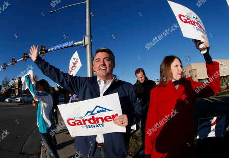 Stock Image of Jamie, Cory Gardner As viewed through fisheye lens, Cory Gardner, left, Republican candidate for the U.S. Senate seat in Colorado, joins his wife, Jamie, and supporters in waving placards on corner of major intersection in south Denver suburb of Centennial, Colo., early on . Gardner is facing Democratic incumbent U.S. Sen. Mark Udall in a pitched battle for the seat