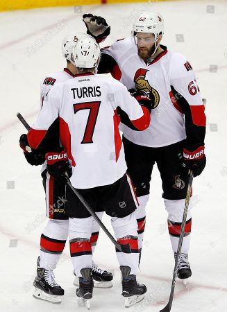 Kyle Turris, Clarke MacArthur, Eric Gryba Ottawa Senators players, Kyle Turris (7), Eric Gryba (62) and Clarke MacArthur (16), celebrate a goal by Turris against the New Jersey Devils during the third period of an NHL hockey game, in Newark, N.J. The Senators won 2-0