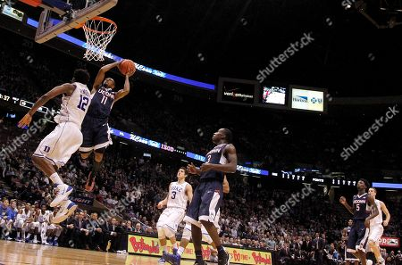 Ryan Boatright, Justise Winslow Connecticut guard Ryan Boatright (11) goes up to shoots against Duke forward Justise Winslow (12) during the first half of an NCAA college basketball game, in East Rutherford, N.J. Duke won 66-56