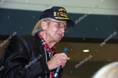 Vietnam War veteran Willard Scott asks a question about health care benefits during a Veterans Affairs town hall meeting in Billings, Mont., on . The agency's acting state director said improvements are occurring despite date that suggests long wait times persist for patients in the VA system