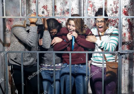 """People react to a mock execution in the Gates of Hell haunted house in Las Vegas. The haunted house is billed as an """"R-rated haunted attraction"""" and according to JT Mollner, a managing partner of Freakling Bros that runs the attraction, about one in five groups are so terrified they exit the house early"""