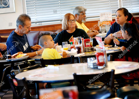 Robert Ochoa Retired U.S. Navy Vietnam veteran Robert Ochoa, left, eats a free lunch with his family at Denny's, in Gilbert, Ariz. Denny's is giving away free lunches to military veterans on Veterans Day