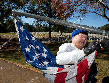 Charles Ferguson Volunteer Charles Ferguson, of Bonaire, Ga., helps rise American flags at Andersonville National Cemetery in Andersonville, Ga. The cemetery is located next the Andersonville prisoner of war camp where almost 13,000 union troops died during the Civil War