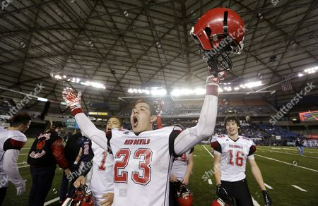 Neah Bay's Christopher Martinez lets out a yell after the team beat Liberty Christian in the Washington state class 1B high school football championship game, in Tacoma, Wash. Neah Bay won 56-38