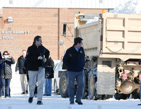 Andrew Cuomo,Mark Poloncarz New York Gov. Andrew Cuomo, left, and Erie County Executive Mark Poloncarz walk past a New York National Guard truck loaded with snow in the south Buffalo area, in Buffalo, N.Y. A snowfall that brought huge drifts and closed roads in the Buffalo area finally ended Friday, yet residents still couldn't breathe easy, as the looming threat of rain and higher temperatures through the weekend and beyond raised the possibility of floods and more roofs collapsing under the heavy loads