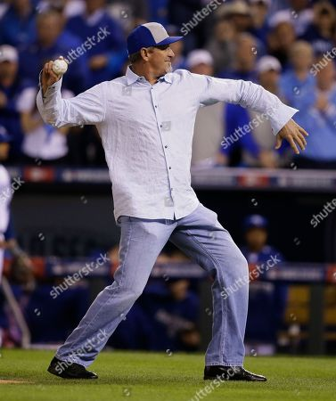 Bret Saberhagen, the MVP of the 1985 World Series, throws out the ceremonial first pitch before Game 7 of baseball's World Series between the Kansas City Royals and the San Francisco Giants, in Kansas City, Mo