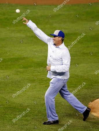 Bret Saberhagen throws out the ceremonial first pitch before Game 7 of baseball's World Series between the Kansas City Royals and the San Francisco Giants, in Kansas City, Mo