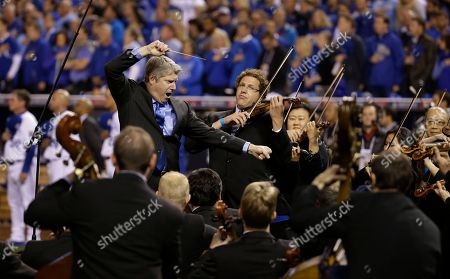 The Kansas City Symphony, conducted by Musical Director Michael Stern, play the national anthem before Game 6 of baseball's World Series between the Kansas City Royals and the San Francisco Giants, in Kansas City, Mo