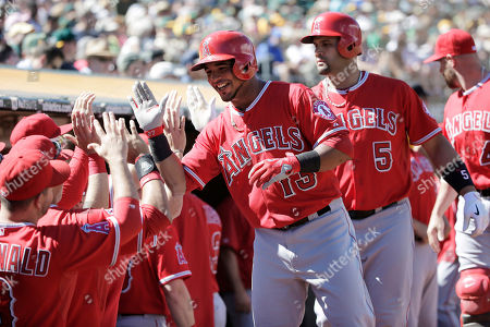 Luis Jimenez, Albert Pujols Los Angeles Angels' Luis Jimenez, center, is high-fived after scoring on a sacrifice fly from Albert Pujols (5) during the fifth inning of a baseball game, in Oakland, Calif