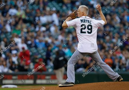 Kenny Mayne Kenny Mayne, who appears on ESPN, throws out the first pitch of a baseball game between the Seattle Mariners and the Los Angeles Angels, in Seattle