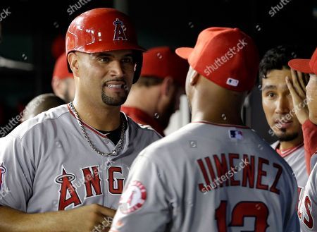 Albert Pujols, Luis Jimenez Los Angeles Angels' Albert Pujols, left, talks with Luis Jimenez (13) in the dugout during a baseball game against the Texas Rangers, in Arlington, Texas